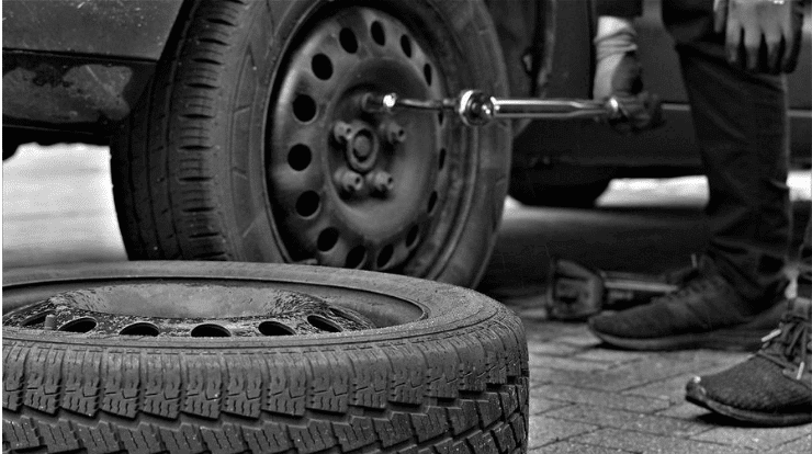 a quiet tyre being installed on a car