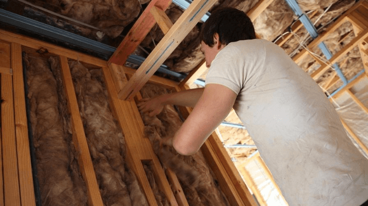 a man installing mineral wool insulation