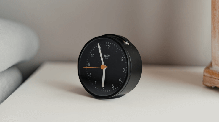 quiet alarm clock on a bed side table