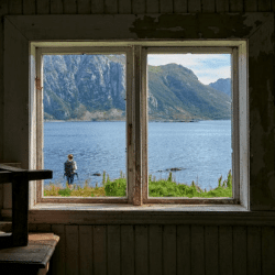 a window overlooking a lake
