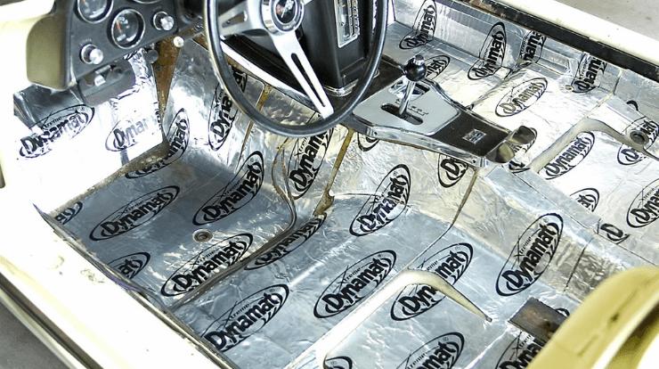 dynamat being installed in a car