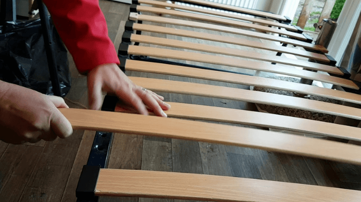 wooden bed frame and slats