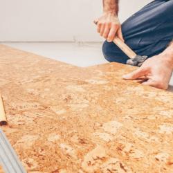 Man installing cork flooring