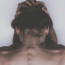 A women holding her head