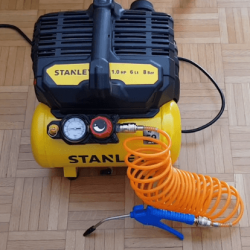 A yellow silent air compressor